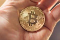 Hand Holding Golden Bitcoin Virtual Money Stock Photography