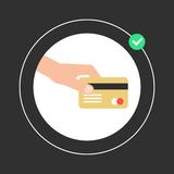Hand holding golden credit card in white circle. Concept of payment of bills, VIP customer, shopping and remittance. isolated on black background. flat style Stock Image