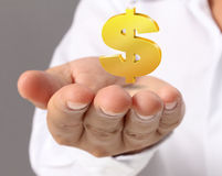 Hand holding Golden dollar simbol Stock Images