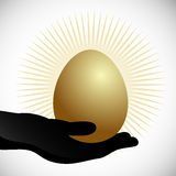 Hand Holding Golden Egg Royalty Free Stock Images