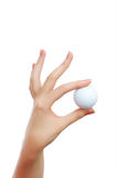 Hand holding golf ball Royalty Free Stock Image