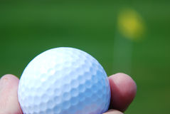 Hand holding golf ball Royalty Free Stock Photo