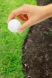 Hand holding golf ball Royalty Free Stock Photography