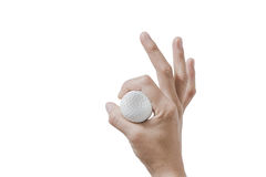 Hand holding golf ball Stock Photography