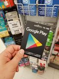 A hand holding a Google Play gift card. MONTREAL, CANADA - NOVEMBER 7, 2017: A hand holding a Google Play gift card. Google Play previously Android Market is a Royalty Free Stock Photos