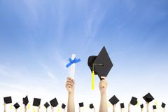 Hand holding graduation hats and diploma Royalty Free Stock Images