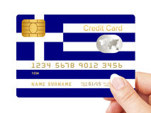 Hand holding greek credit card isolated over white Royalty Free Stock Photo