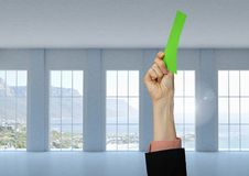 Hand holding green card by windows. Digital composite of Hand holding green card by windows Stock Photo