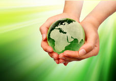 Hand holding the green Earth Royalty Free Stock Images