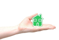 Green Eco house icon. Hand holding green Eco house icon concept Royalty Free Stock Photography