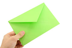 Hand holding green envelope. Concept of communication Royalty Free Stock Photography