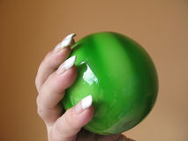 Hand holding green glass melon Stock Image