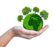 Hand holding green planet with trees Stock Images