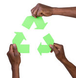 Hand holding green recycling arrows symbol Stock Photos