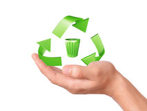 Hand holding green Recycling symbol Stock Photo