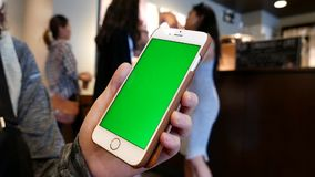 Hand holding green screen iphone stock footage