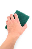 Hand holding green scrubber Royalty Free Stock Photo