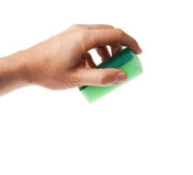 Hand holding green sponge Royalty Free Stock Photography