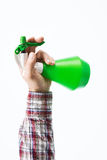 Hand holding a green sprayer Stock Images