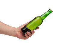Hand holding a green transparent bottle Stock Photography