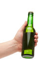 Hand holding a green transparent bottle Stock Images