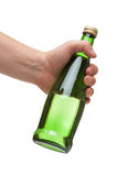 Hand holding a green transparent bottle. Isolated on white Royalty Free Stock Images