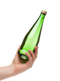 Hand holding a green transparent bottle Royalty Free Stock Photography