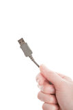 Hand holding grey USB cable Stock Images