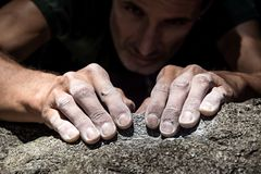 Hand holding grip. Man`s hand climbing on granite. Italian Alps Stock Photography