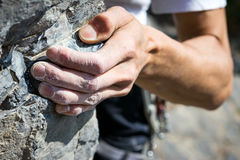 Hand holding grip. Man's hand climbing on limestone. Muzzerone mountain, Liguria, Italy royalty free stock image