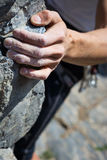 Hand holding grip. Man's hand climbing on limestone. Muzzerone mountain, Liguria, Italy royalty free stock photo
