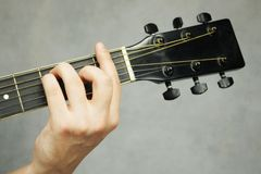 Hand holding guitar Stock Image
