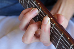 Hand holding guitar chord Stock Photo