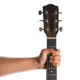 Hand holding guitar Royalty Free Stock Photos