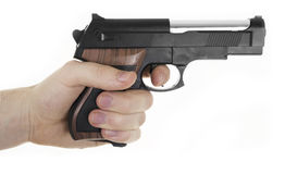 Hand holding Gun Stock Photography