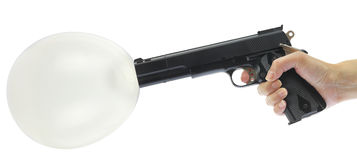 Hand holding gun with balloon Stock Photography