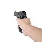 Hand holding gun Stock Photo
