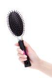 Hand holding hair brush Royalty Free Stock Image