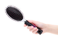 Hand holding hairbrush Stock Image