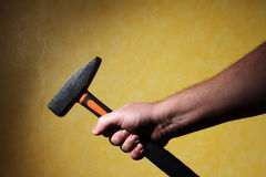 Hand holding a hammer. Mens hand holding a hammer Royalty Free Stock Photo