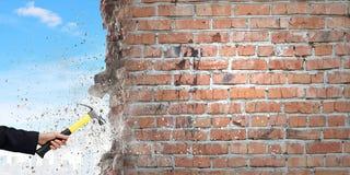 Hand holding hammer Stock Photo