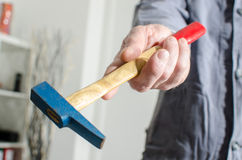 Hand holding a hammer Stock Image