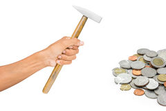 Hand holding hammer. With coins  on white background Royalty Free Stock Image