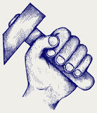 Hand holding hammer Royalty Free Stock Image