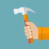 Hand holding hammer Royalty Free Stock Images