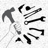 Hand holding hammer with pattern of tool background Stock Images
