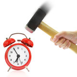 Hand holding hammer and red alarm clock Stock Image