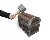 Hand holding hammer to hit old treasure chest. Isolated on white background Royalty Free Stock Images