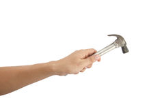 The Hand holding a hammer. Stock Images