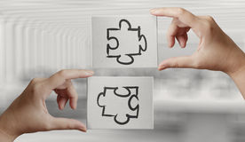 Hand holding hand drawn  Partnership Puzzle Stock Images